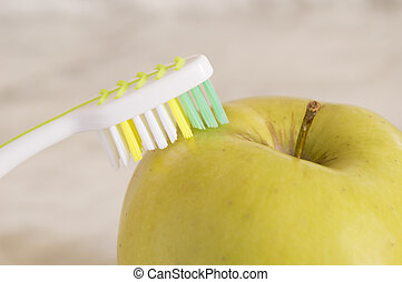 Apples with a toothbrush isolated on marble