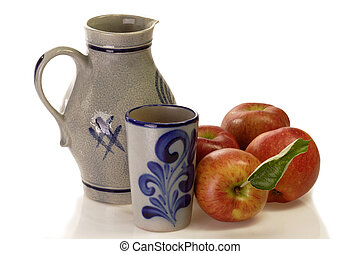 Jug of apple wihe with fresh apples on bright background