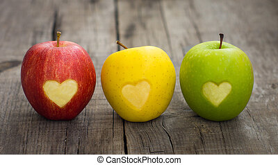 Apples with engraved hearts - Three apples with engraved...