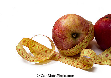 apples with measuring tape isolated