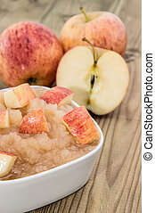 Applesauce with Apples on wooden background