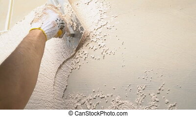 application of facade plaster - application and uniform...