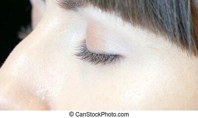 Apply mascara on eyelashes - Models with closed eyes Apply...