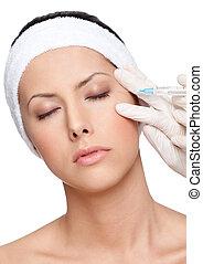 Applying botox eyelid correction, isolated, white background