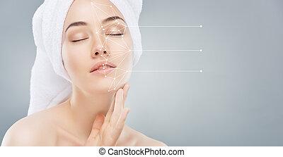 applying cosmetic cream - beautiful woman applying cosmetic...