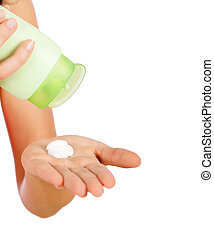 Applying Cream - Woman holding and applying cream isolated...