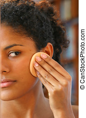 Applying foundation - Beautiful brazilian girl applying ...