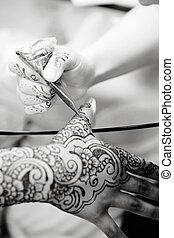Applying Henna - A Hindu Bride has Henna applied to her...