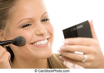 Applying makeup - Happy young woman applying makeup,...