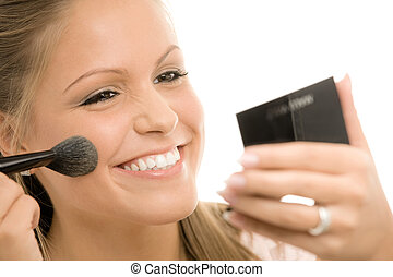 Applying makeup - Happy young woman applying makeup,...