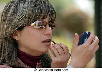 Applying makeup - Woman applying makeup