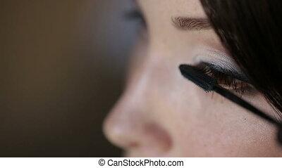 Applying Mascara, Make Up - woman uses mascara for the bride