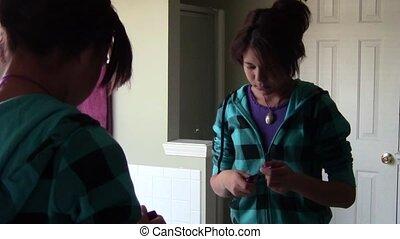 Applying Mascara - Teen applying mascara