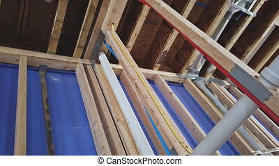 Applying pipe drain plumbing with hot red and cold blue pex ...