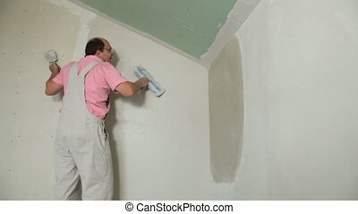 Applying Plaster to Plasterboard Wall