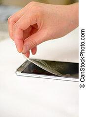 Applying screen protector on smartphone