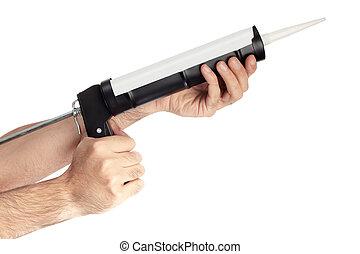Applying silicone with caulk gun - Applying silicone sealant...