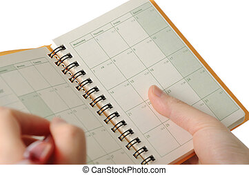 Appointment book - Business woman making appointment on...