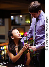 Appointment - Image of man giving a red rose to his...