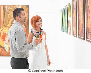 appreciating contemporary art - young caucasian couple...