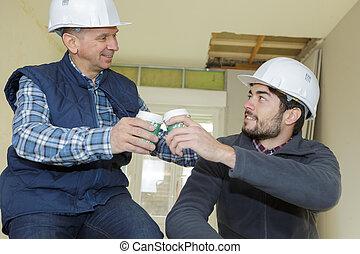apprentice and mentor enjoying coffee break