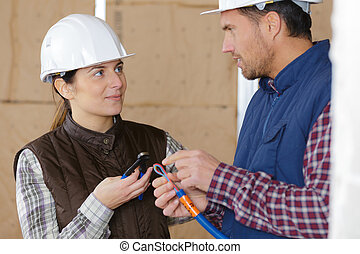 apprentice construction worker with mentor