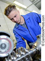 Apprentice engineer with metal gear