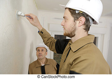 apprentice painting railing