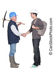 Apprentice shaking hands