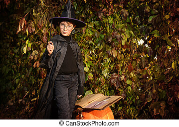 apprentice wizard - A boy in a costume of wizard with his...