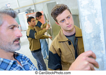 Apprentices learning a trade