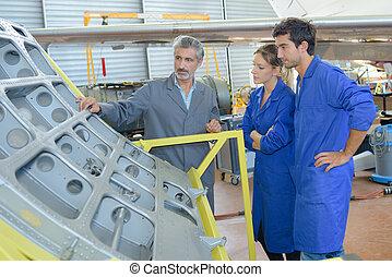apprentices with professional metallurgist