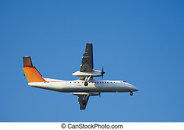 approach Turboprop Engines flight in blue sky - approach...