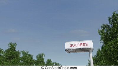 Approaching big highway billboard with Success caption.