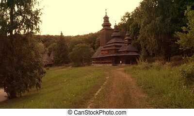 Approaching dark spooky orthodox church. Village church in a forest.