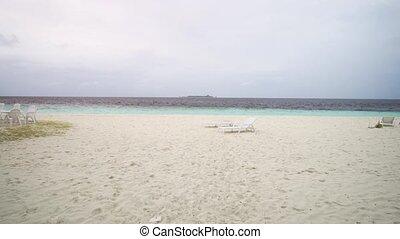 Approaching the Sea across a Sandy Beach in Maldives