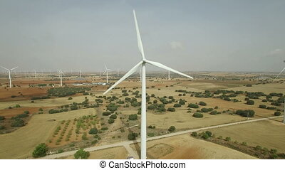Approaching to wind turbine, aerial view - Front view of...
