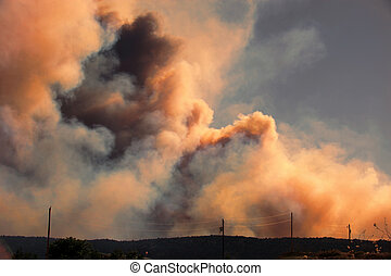 Approaching Wildfire - Clouds of smoke billowing up from out...