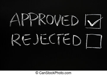 Approved and rejected checkboxes on a blackboard, with ...