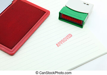 approved stamp on paper with rubber stamp