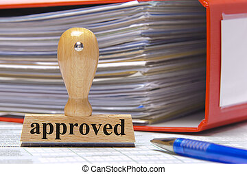 approved - rubber stamp in office marked with approved