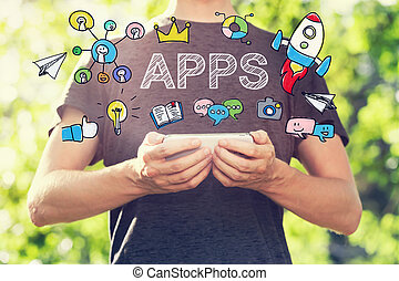 APPS concept with young man holding his smartphone