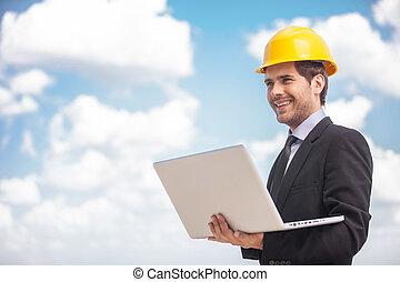 appy Architect Man Holding Laptop. Young man in business ...