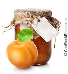 Apricot and jam in a jar isolated on white