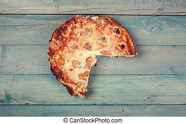Apricot cake on wooden background