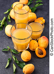 Apricot juice in glass. Healthy drink