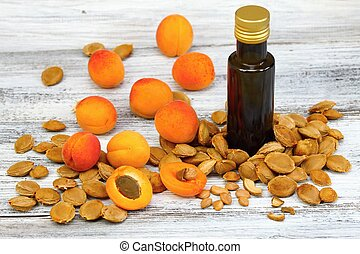 Apricot oil from apricot kernels in a brown bottle , apricot...