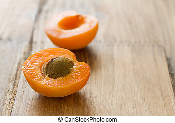 apricot on brown wooden background