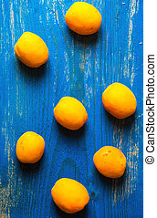Apricot on old wooden background