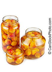 Apricots canned in glass jars isolated on white background